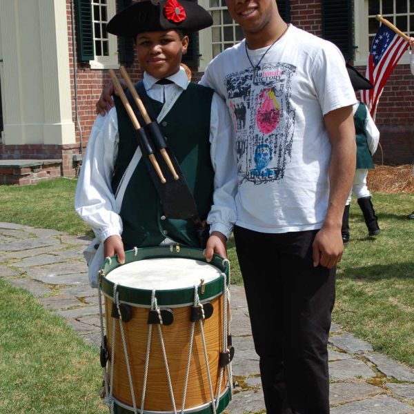 Boy dressed up as colonial drummer