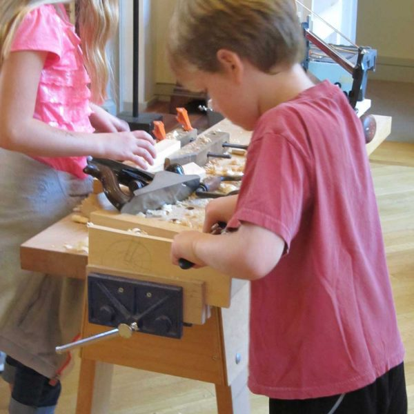 Kids learning woodoworking at the Concord Museum